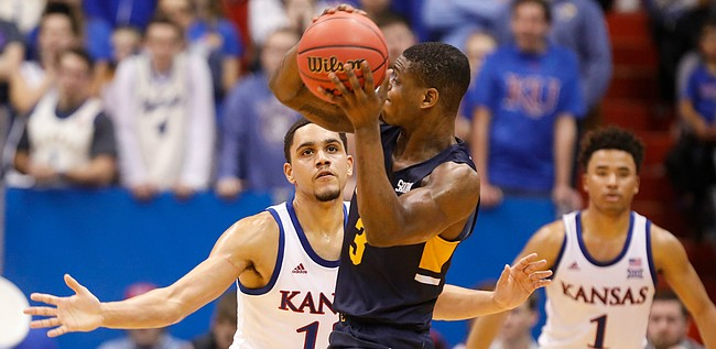 Kansas guard Tristan Enaruna defends against a pass from East Tennessee State guard Bo Hodges (3) during the second half on Tuesday, Nov. 19, 2019 at Allen Fieldhouse.