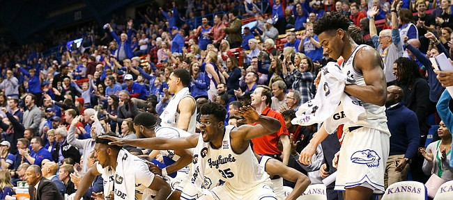 Kansas center Udoka Azubuike (35) and the Jayhawk bench react to a three from Kansas guard Chris Teahan (12) during the second half, Tuesday, Dec. 10, 2019 at Allen Fieldhouse.
