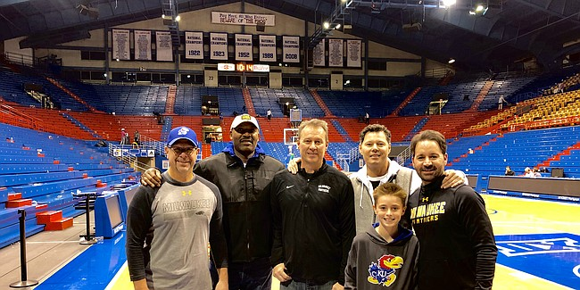 Olofu Agbaji, second from left, and four of his close friends and former basketball teammates from his college playing days in Milwaukee get together for a photograph to document their reunion and memorable night at Allen Fieldhouse on Dec. 10, 2019. The group was in town to watch their alma mater and Olofu's son, Ochai Agbaji, take on the Jayhawks during a game won by Kansas, 95-68. Joining Olofu Agbaji are, from left to right, Mike Gramins, Mike Haessly, Paul Halstead, Jack Westerman and Jim Westerman.