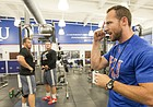 New KU football strength coach Zac Woodfin paces around the weight room during a workout at the Anderson Family Football Complex on Thursday, June 29, 2017.