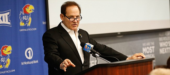 Kansas head football coach Les Miles talks with media members during a signing day press conference on Wednesday, Dec. 18, 2019 in Mrkonic Auditorium.