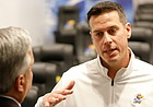 Kansas defensive coordinator D.J. Eliot talks with media members following head coach Les Miles' signing day press conference on Wednesday, Dec. 18, 2019 in Mrkonic Auditorium.