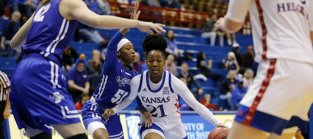 Kansas guard Brooklyn Mitchell (21) attempts to get past Indiana State guard Del'Janae Williams (51) during an NCAA women's basketball game on Nov. 7, 2019, in Lawrence, Kan.