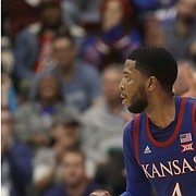 Kansas guard Isaiah Moss (4) runs upcourt after shooting a three-point basket against Stanford during the second half of an NCAA college basketball game in Stanford, Calif., Sunday, Dec. 29, 2019. (AP Photo/Jeff Chiu)
