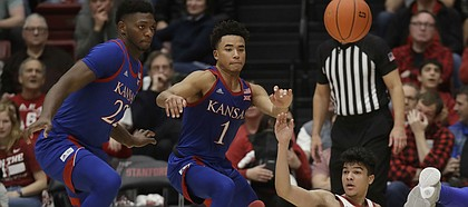 Stanford guard Tyrell Terry (3) loses the ball next to Kansas forward Silvio De Sousa (22) and guard Devon Dotson (1) during the second half of an NCAA college basketball game in Stanford, Calif., Sunday, Dec. 29, 2019. (AP Photo/Jeff Chiu)