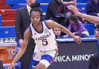 Kansas sophomore Aniya Thomas (5) makes a move to drive to the rim during KU's nonconference finale Monday night at Allen Fieldhouse on Dec. 30, 2019.