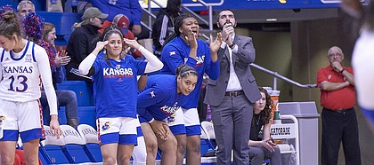 The Kansas bench celebrates a 3-pointer in the second quarter during KU's nonconference finale Monday night at Allen Fieldhouse on Dec. 30, 2019.
