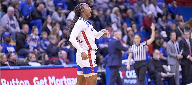 Kansas sophomore Brooklyn Mitchell (21) celebrates after she creates a turnover during KU's nonconference finale Monday night at Allen Fieldhouse on Dec. 30, 2019.