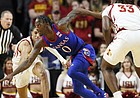Kansas guard Marcus Garrett (0) races for the ball between Iowa State's Tyrese Haliburton and Solomon Young, right, during the first half of an NCAA college basketball game Wednesday, Jan. 8, 2020, in Ames, Iowa. (AP Photo/Charlie Neibergall)