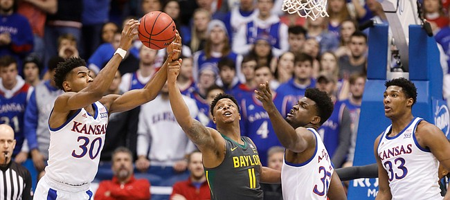 Kansas Jayhawks guard Ochai Agbaji (30) comes away with an offensive rebound from Baylor Bears guard Mark Vital (11) during the first half on Saturday, Jan. 11, 2020 at Allen Fieldhouse.