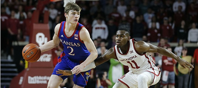 Kansas' Christian Braun (2) is defended by Oklahoma's De'Vion Harmon (11) during the first half of an NCAA college basketball game in Norman, Okla., Tuesday, Jan. 14, 2020.
