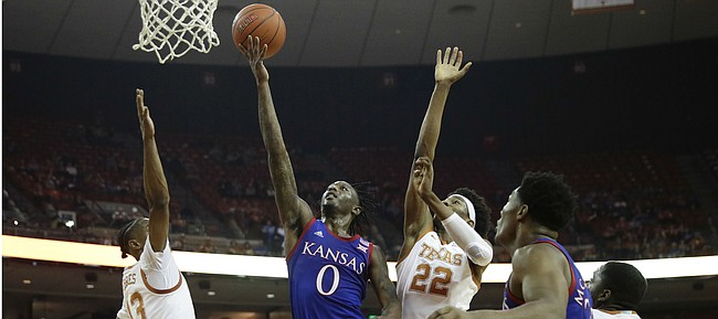 Kansas guard Marcus Garrett (0) shoots past Texas forward Kai Jones (22) during the first half of an NCAA college basketball game, Saturday, Jan. 18, 2020, in Austin, Texas. (AP Photo/Eric Gay)