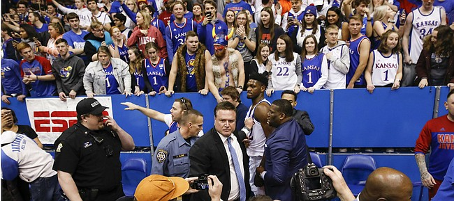 Kansas head coach Bill Self holds back Kansas forward Silvio De Sousa (22) following the Jayhawks' win against Kansas State, Tuesday, Jan. 21, 2020 at Allen Fieldhouse.