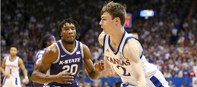 Kansas guard Christian Braun (2) goes baseline against Kansas State forward Xavier Sneed (20) during the first half, Tuesday, Jan. 21, 2020 at Allen Fieldhouse.