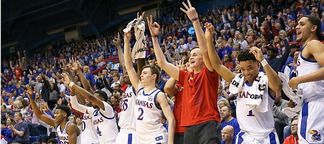 The Kansas bench reacts to a three from Kansas guard Michael Jankovich (20) late in the second half, Tuesday, Jan. 21, 2020 at Allen Fieldhouse.