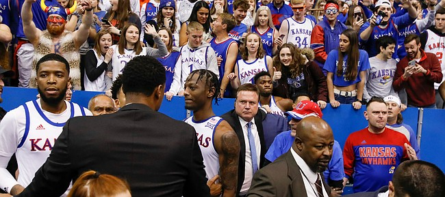 Kansas head coach Bill Self holds back Kansas forward Silvio De Sousa (22) and Kansas guard Isaiah Moss (4) and Kansas guard Marcus Garrett (0) are held back by a member of the Kansas State coaching staff during a brawl following the Jayhawks' win against Kansas State, Tuesday, Jan. 21, 2020 at Allen Fieldhouse.