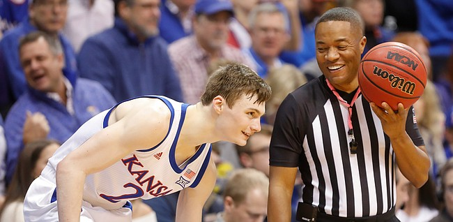 Kansas guard Christian Braun (2) laughs with a game official during the second half, Tuesday, Jan. 21, 2020 at Allen Fieldhouse.