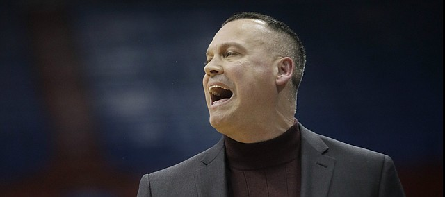 Kansas coach Brandon Schneider yells to his team during the first half of an NCAA college basketball game against Baylor in Lawrence, Kan., on Wednesday, Jan. 15, 2020.