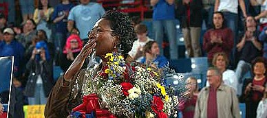 Former Kansas University women's basketball coach Marian Washington, center, kisses the crowd goodbye before KU's game against Nebraska on Saturday, Feb. 28, 2004, when Washington officially retired at Allen Fieldhouse.