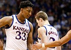 Kansas forward David McCormack (33) slaps hands with Kansas guard Devon Dotson (1) late in the second half, Saturday, Feb. 1, 2020 at Allen Fieldhouse.