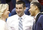 Former Kansas strength coach and current Texas strength coach Andrea Hudy is greeted by Kansas staff members Brennan Bechard, center, and Jeremy Case prior to tipoff on Monday, Feb. 3, 2020 at Allen Fieldhouse.