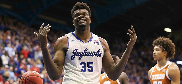 Kansas center Udoka Azubuike (35) accepts the applause of the crowd after getting a bucket and a Texas foul during the second half on Monday, Feb. 3, 2020 at Allen Fieldhouse.
