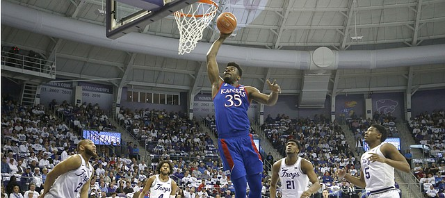 Kansas center Udoka Azubuike (35) dunks against TCU defenders guard Edric Dennis (2), PJ Fuller (4,) Kevin Samuel (21) and Charles O'Bannon Jr. (5) during the first half of an NCAA college basketball game, Saturday, Feb. 8, 2020, in Fort Worth, Texas. (AP Photo/Ron Jenkins)