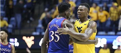 Kansas center Udoka Azubuike (35) and West Virginia forward Oscar Tshiebwe (34) greet each other after an NCAA college basketball game Wednesday, Feb. 12, 2020, in Morgantown, W.Va. (AP Photo/Kathleen Batten)