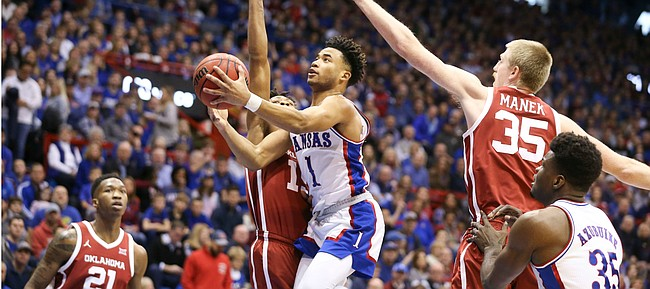 Kansas guard Devon Dotson (1) elevates for a bucket against Oklahoma during the first half on Saturday, Feb. 15, 2020 at Allen Fieldhouse.