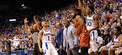 Kansas guard Devon Dotson (1) erupts after hitting a three-pointer in front of Iowa State guard Tre Jackson (3) during the second half on Monday, Feb. 17, 2020 at Allen Fieldhouse.