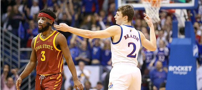 Kansas guard Christian Braun (2) celebrates a three-pointer next to Iowa State guard Tre Jackson (3) during the first half on Monday, Feb. 17, 2020 at Allen Fieldhouse.