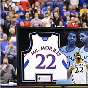 Kansas great Marcus Morris addresses the Fieldhouse crowd during a halftime ceremony in which his jersey was retired.