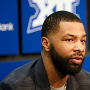 Former Kansas forward Marcus Morris, who is with the Los Angeles Clippers talks with media members alongside his brother Markieff Morris, who is with the Detroit Pistons, during a press conference prior to tipoff on Monday, Feb. 17, 2020 at Allen Fieldhouse.