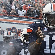FILE — In this 2014 file photo, Auburn quarterbacks Jonathan Wallace (12) and Sean White (13) run out onto the football field of an NCAA college football game against LSU on Saturday, Oct. 4, 2014, in Auburn, Ala. (AP Photo/Brynn Anderson)