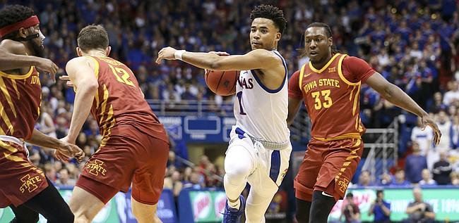 Kansas guard Devon Dotson (1) makes a move to the bucket against several Iowa State defenders during the second half on Monday, Feb. 17, 2020 at Allen Fieldhouse.