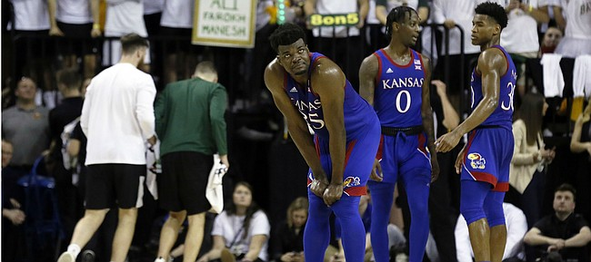 Kansas center Udoka Azubuike looks up at the scoreboard during a timeout in the second half of an NCAA college basketball game against Baylor on Saturday, Feb. 22, 2020, in Waco, Texas. (AP Photo/Ray Carlin)