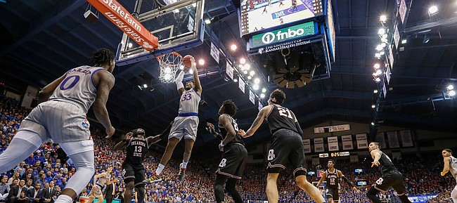 Kansas forward David McCormack (33) follows up a missed shot with a dunk during the first half on Monday, Feb. 24, 2020 at Allen Fieldhouse.