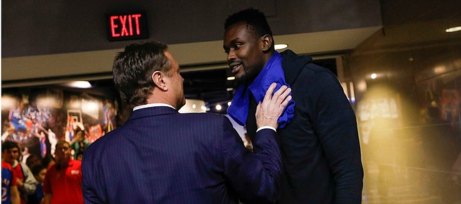 Kansas head coach Bill Self is greeted by Kansas center Udoka Azubuike's brother Chima Azuonwu following The Jayhawks' 83-58 win over Oklahoma State on Monday, Feb. 24, 2020 at Allen Fieldhouse.