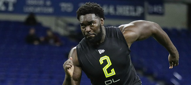 Kansas offensive lineman Hakeem Adeniji runs a drill at the NFL football scouting combine in Indianapolis, Friday, Feb. 28, 2020. (AP Photo/Michael Conroy)
