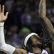 Kansas guard Marcus Garrett (0) shoots over Kansas State guard Cartier Diarra (2) during the first half of an NCAA college basketball game in Manhattan, Kan., Saturday, Feb. 29, 2020. (AP Photo/Orlin Wagner)