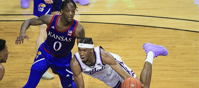 Kansas State forward Xavier Sneed, right, turns the ball over while covered by Kansas guard Marcus Garrett (0) during the second half of an NCAA college basketball game in Manhattan, Kan., Saturday, Feb. 29, 2020. Kansas defeated Kansas State 62-58. (AP Photo/Orlin Wagner)