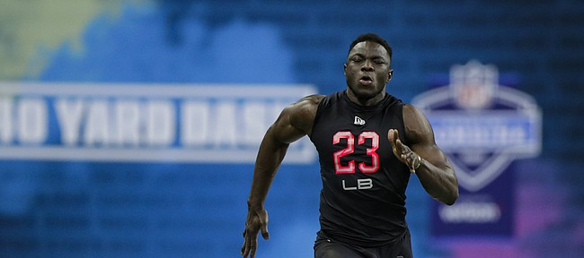 Kansas linebacker Azur Kamara runs the 40-yard dash at the NFL football scouting combine in Indianapolis, Saturday, Feb. 29, 2020. (AP Photo/Michael Conroy)