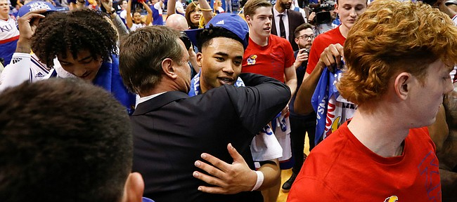 Kansas head coach Bill Self hugs Kansas guard Devon Dotson (1) after the Jayhawks defeated TCU to claim at least a share of the Big 12 conference title on Wednesday, March 5, 2020 at Allen Fieldhouse.
