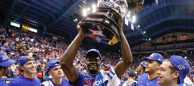 Kansas center Udoka Azubuike (35) hoists the Big 12 conference trophy after the Jayhawks defeated TCU 75-66 to claim at least a share of it on Wednesday, March 5, 2020 at Allen Fieldhouse.