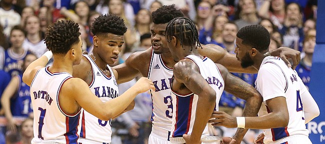 The Jayhawks huddle up during the second half, Wednesday, March 5, 2020 at Allen Fieldhouse.