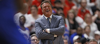 Kansas coach Bill Self laughs on the sidelines during the second half of an NCAA college basketball game against Texas Tech, Saturday, March 7, 2020, in Lubbock, Texas. (AP Photo/Brad Tollefson)