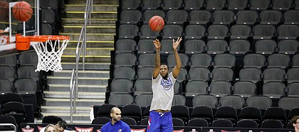 Kansas guard Isaiah Moss (4) puts up a three during practice on Wednesday, March 11, 2020 at Sprint Center.
