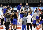 Kansas head coach Bill Self talks to his players, coaches and staff on the court during practice on Wednesday, March 11, 2020 at Sprint Center. On Wednesday afternoon, the NCAA announced that upcoming basketball tournaments would be played without fans because of concerns about the spread of the coronavirus.