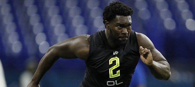 Kansas offensive lineman Hakeem Adeniji runs a drill at the NFL football scouting combine in Indianapolis, Friday, Feb. 28, 2020. (AP Photo/Charlie Neibergall)