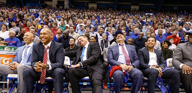 Kansas head coach Bill Self laughs with members of his coaching staff as Kansas center Udoka Azubuike (35) tells a story about him during the senior speeches.
